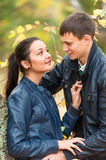 Young romantic happy couple in autumn park Royalty Free Stock Images