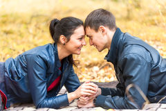 Young romantic happy couple on autumn picnic Royalty Free Stock Image