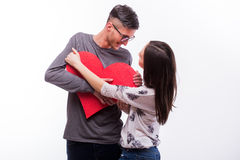 Young romantic love hipster couple  fight for a red heart, man wins. Stock Photos