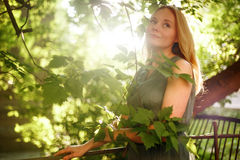 Young Romantic Meditative Woman in Summer. Day. Outdoor Portrait. Selective Soft Focus, Shallow Depth of Field, Backlight Royalty Free Stock Photo