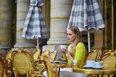 Young romantic Parisian girl drinking coffee Stock Photo