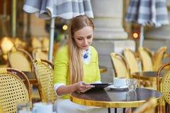 Young romantic Parisian girl drinking coffee Royalty Free Stock Photos