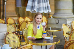 Young romantic Parisian girl drinking coffee Royalty Free Stock Images