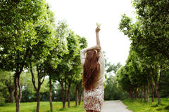 Young romantic woman dancing with flowers. Romantic summer Stock Photo