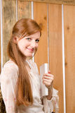 Young romantic woman hold book in barn Stock Photos
