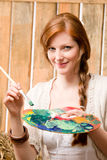 Young romantic woman hold color palette barn. Young romantic red-hair woman painting hold color palette in barn stock photo
