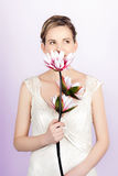 Young romantic woman with lotus flowers Royalty Free Stock Photography