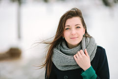 Young romantic woman in scarf and coat closeup winter outdoors Stock Photos