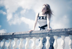 Young romantic woman standing at the railing Royalty Free Stock Photo