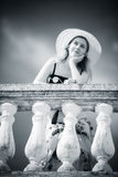 Young romantic woman standing at the railing Royalty Free Stock Images