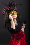 Young romany woman posing on carnaval with mask Royalty Free Stock Photo
