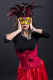 Young romany woman wonder on carnaval with mask Stock Images