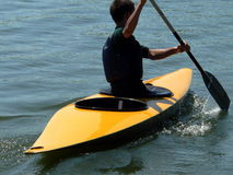 Young rower. On kayak Stock Images