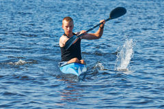 The young rower's training on the racing kayak Stock Photo