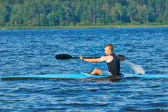 The young rower's training on the racing kayak Stock Photos