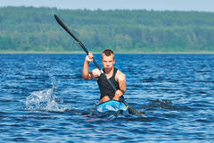 The young rower's training on the racing kayak Royalty Free Stock Image