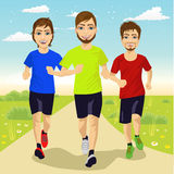 Young runner men running outdoors. Full body portrait of young runner men running outdoor Royalty Free Stock Photo