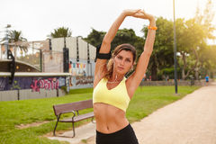 Young runner muscle stretching while standing Royalty Free Stock Photos