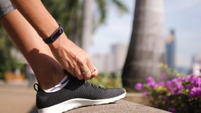 Young Runner Woman Tying Sneakers Running Shoe Laces in Park. 4K, Slow Motion Close Up. Bangkok, Thailand. Young Runner Woman Tying Sneakers Running Shoe Laces stock video footage