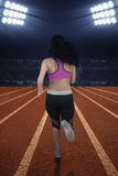 Young runner workout in stadium Royalty Free Stock Photography
