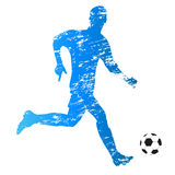 Young running soccer player Royalty Free Stock Photo