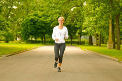 Young running woman Royalty Free Stock Photos