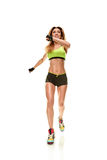 Young running woman. Full-length photo of running woman on white background Royalty Free Stock Image