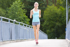 Young running woman trains her stamina outdoor Stock Photo