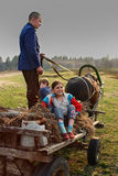 Young rural people are traveling to the cart horse drawn. Royalty Free Stock Photos