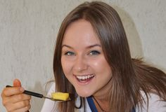 Young Russian model eating slice of pineapple Royalty Free Stock Image