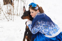 Young russian woman with dog Stock Photography