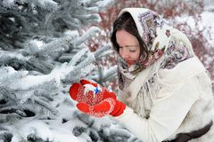 Young Russian woman in winter park Stock Photos
