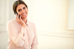 Young 30s lady talking on her cellphone Stock Photography