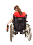 Young sad alcoholic woman on the wheelchair Stock Photos