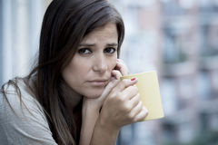 Young sad beautiful woman suffering depression looking worried and wasted on home balcony Royalty Free Stock Photos