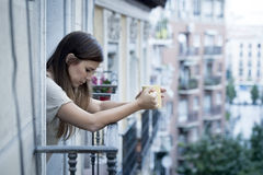 Young sad beautiful woman suffering depression looking worried and wasted on home balcony Royalty Free Stock Image