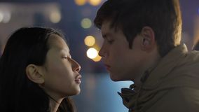 Young sad couple having farewell kiss, long distance relationship, separation. Stock footage stock video footage