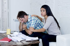 Young sad couple at home living room couch calculating monthly expenses worried in stress Stock Photography
