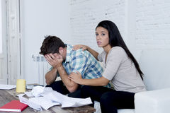 Young sad couple at home living room couch calculating monthly expenses worried in stress Stock Photo