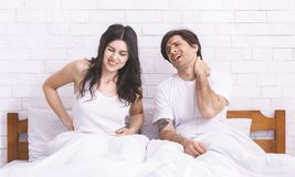Free Young Sad Couple Waking Up, Suffering From Back And Neck Ache Stock Photos - 161083033
