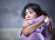 Young sad and depressed Asian Chinese woman crying alone desperate sitting at home sofa ouch worried in pain and stress suffering. Depression and anxiety stock photos