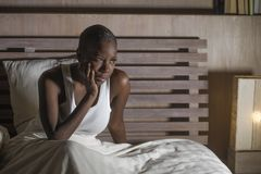 Young sad depressed black african American woman in bed sleepless feeling desperate worried suffering depression problem insomnia. Young sad and depressed black royalty free stock photos