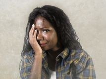Young sad and depressed black African American woman crying anxious and overwhelmed feeling sick and stressed on studio b. Ackground suffering depression problem royalty free stock image