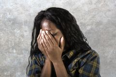 Young sad and depressed black African American woman crying anxious and overwhelmed feeling sick and stressed on studio b. Ackground suffering depression problem royalty free stock photos