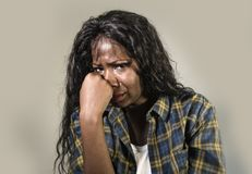 Young sad and depressed black African American woman crying anxious and overwhelmed feeling sick and stressed on studio b. Ackground suffering depression problem royalty free stock photo