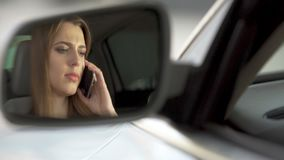 Young sad female sitting on driver's seat and talking with boyfriend, break-up. Stock footage stock footage