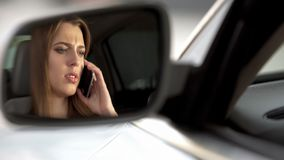 Young sad female sitting on driver seat and talking with boyfriend, break-up. Stock photo stock image