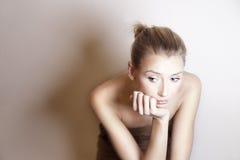 Young sad girl looking away. Stock Image