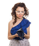 Young sad girl looking at her empty wallet. Isolated on white. Bankruptcy Royalty Free Stock Photos