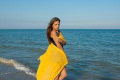 Young sad girl near sea on sunset Royalty Free Stock Images